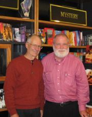 Giving forth with two generations of booksellers to his left